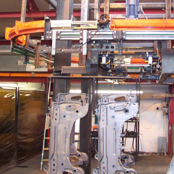 Chassis components on a MCM Powertrack 100 conveyor