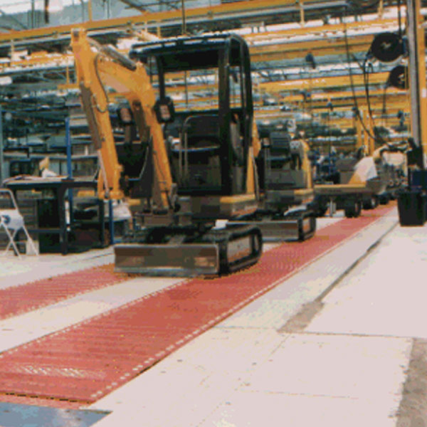 Mini excavators on an Amber Automation HD slat conveyors
